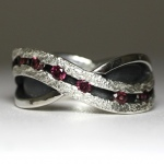 hand made sterling silver wedding band with rhodolite gemstones