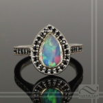 hand made Fiery Opal and Black Spinel Halo Ring in 14k white gold