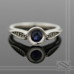 midnight blue sapphire and black diamond engagement ring in solid 14k white gold