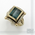 green tourmaline and diamond halo statement ring in 14k yellow gold