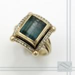 green tourmaline and diamond halo statement ring in 14k yellow gold
