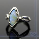 Semi black opal in 14k white palladium gold
