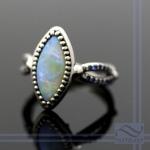 Semi black opal in 14k white palladium gold