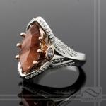 Oregon sunstone and diamond engagement ring