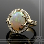 Hand made solid Australian opal diamond halo ring in 14k yellow gold