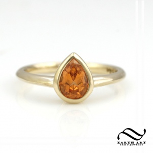 pear cut spessartite orange garnet solitaire engagement ring