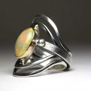 Ethiopian opal ring hand made in sterling silver with a gold bezel