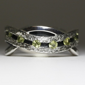 hand made peridot eternity band in sterling silver