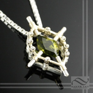 Unique tension set peridot pendant in mixed metal