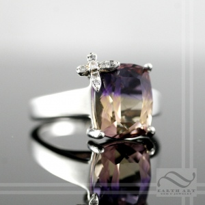 Butterfly on prong in ametrine ring