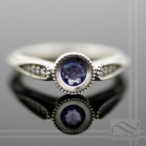 hand made tanzanite and Diamond Engagement ring