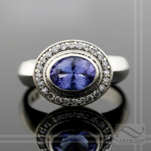 hand made tanzanite diamond halo ring