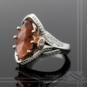 Oregon sunstone and diamond engagement ring