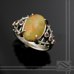 Bold hand made Ethiopian opal ring with pink topaz