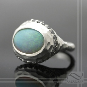 Solid natural Australian opal halo ring in sterling silver