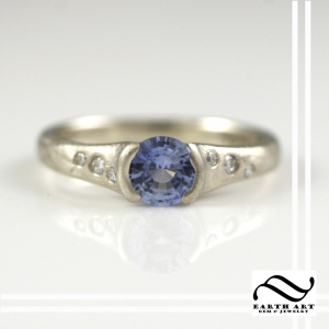 Blue Ceylon Sapphire Engagement ring in brushed white gold with diamonds