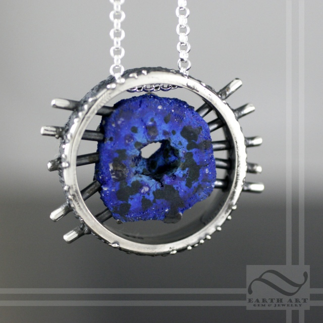 Azurite slice suspended in Silver