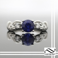 Sapphire & Platinum Figure 8 Knot Ring
